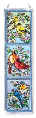 "Amia Beveled Glass Triptych Decor Panel Songbird Design, 4-1/2 by 16-Inch, Hand-Painted on Glass by Amia. $29.00. Optional wrought iron stand available.  go to amazon and search for amia 6682 wrought iron stand to order. Includes chain for hanging. Comes in a gift box. Themed trio designs in hand-painted glass artwork are positively ""top hits.""  Beautiful design with rich colors will make a nice statement to your décor."