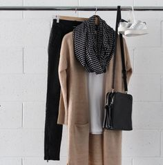 Longline Cardigan: The longline cardigan is a layering staple. Choose a neutral shade that goes with everything and the longer style flatters most figures. I love to team long cardigans with fitted bottoms and for a relaxed weekend style sneakers and a slouchy tee.
