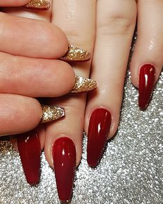 Red gel nails with gold glitter underneath