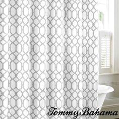 The Tommy Bahama Shoretown Trellis Lagoon shower curtain is an elegant addition to any modern decor. Constructed of 100-percent cotton, this shower curtain features a grey trellis pattern on a white background.