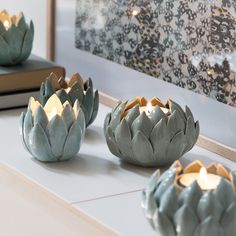 A beautiful display of ceramic water lilies, in Anna's opinion. Tealight holders, available in four colours, prices from DKK 22,90 / EUR 3,24 / ISK 1254 / NOK 32,60 / GBP 3,18 / SEK 32,40