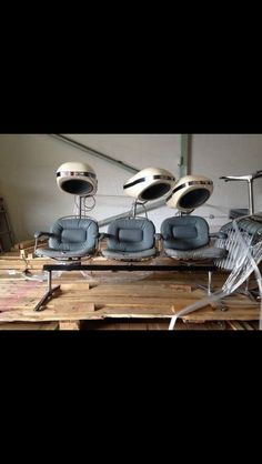 Vintage hairdressing chairs with hair drier hoods.