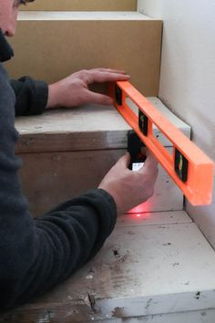 A picture of Todd measuring each stair riser to be covered.