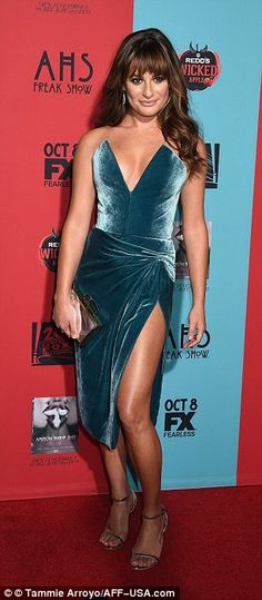 All glamour: She looked incredible in a low-cut high-slit dress by Cushnie et Ochs, which she wore with a simple pair of earrings