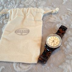 Fossil Tortoise Shell Watch W/Rhinestones Shows normal signs of wear, small scratches on face and band. Needs battery. Comes with dust bag. I do NOT trade. Reasonable offers will be considered. Tortoise Shell Watch, Fossil Watches, Rhinestones, Dust Bag, Band, Signs, How To Wear, Accessories, Sash