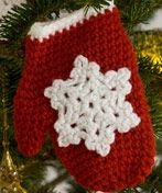 Crochet Snowflake Mitten Ornaments - This is an intermediate crochet project that you can return to year after year. #pattern