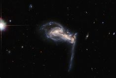 A dramatic triplet of galaxies takes center stage in this image from the NASA/ESA Hubble Space Telescope, which captures a three-way gravitational tug-of-war between interacting galaxies. James Webb Space Telescope, Hubble Space Telescope, Nasa Hubble Images, Cosmos, Les Satellites, Solar System Exploration, Sibling Fighting, Nasa Goddard, Tug Of War