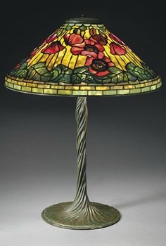 TIFFANY STUDIOS   A 'Poppy' Leaded Glass and Bronze Table Lamp, circa 1910   26½ in. (67.3 cm.) high, 20¼ in. (51.5 cm.) diameter of shade   shade stamped TIFFANY STUDIOS NEW YORK 1531, base stamped TIFFANY STUDIOS NEW YORK 443
