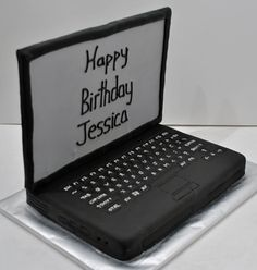 A dairy-free vanilla cake designed to look like a black laptop computer.  The cake and buttercream is all dairy free and serves 15.  Details on the key board are done with royal icing as well as ed…