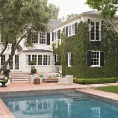 A California Home Gets A Bit Of New England Prep, classic pool design, brick pavers, ivy covered exterior, white clapboard house with ivy New England Prep, Studio Mcgee, Outdoor Patio Pavers, Colonial House Exteriors, Beverly Hills Houses, The Ivy Beverly Hills, Villa, California Homes, House Goals