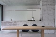 Kitchen: cement kitchen with timber table (photo: Giorgio Possenti).