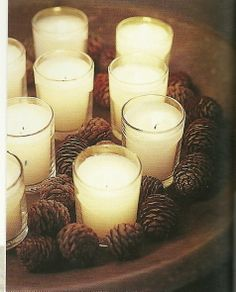 candles with pinecones  #pinecones