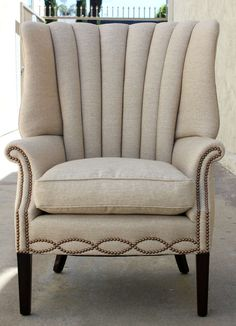 Dislike the channels on this style of wing.. however... LOVE the nailhead detail to contemporize a standard wing
