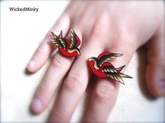 black tan and red kissing tattoo sparrow statement ring