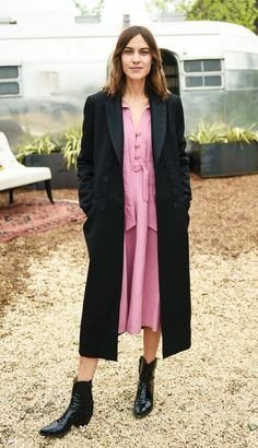 Alexa Chung just wore the perfect Spring outfit in New York, pairing a pink dress with cowboy boots. Shop her look here.