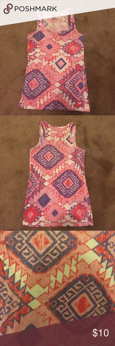 American Eagle Aztec print tank top. This colorful Aztec tank is the perfect colorful addition to your wardrobe for Spring & Summer. It's a size S but fits more like an XS. American Eagle Outfitters Tops Tank Tops