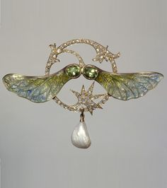 Georges Fouquet: An Art Nouveau gold, enamel, diamond, peridot and pearl 'Sycamore' pendant, by Georges Fouquet, 1905-10. #Fouquet #ArtNouveau #pendant