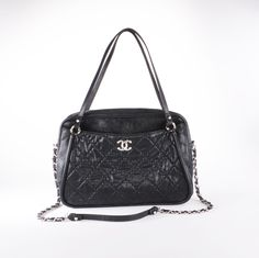 Chanel Tote with iconic quilted leather and chain. Get it second-hand at Union & Fifth.