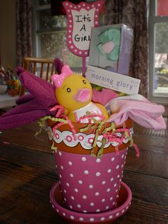 Hand painted flower pot. I used acrylic paints and enamel paint pens. I tucked in baby items and a rubber ducky!