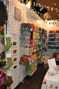 https://flic.kr/p/9jfgZk | Sunshine Yarns Stitches booth side view | Sock patterns, inspirational pictures, etc.