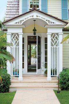 """""""The main entrance should be an experience,"""" says architectural designer Terry Pylant of Historical Concepts. A new portico frames the aligned front and back doors. Now, guests see straight through the home to the water."""