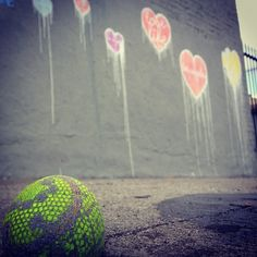 "my version of street art is not the painting on the walls but the lacy neon ""love"" rock on the ground, signed ""xoxo nono"" ... if you find one, it's yours!"