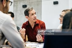 Stock Photo : MAture man speaking in a business meeting.