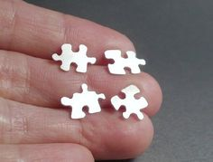 Jigsaw puzzle piece earrings.