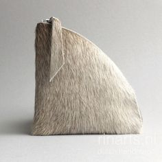 Cow hair triangle purse in beige and light gray tones