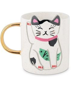 With a lucky cat design and ears incorporated into the rim, this white ceramic mug is completed with 'feeling lucky' written across the back and a gold toned handle.