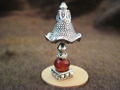 this is an interesting miniature table lamp