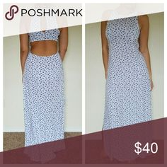 NWOT Cut-out White & Blue Floral Maxi Dress New without tags condition white and floral blue cut out maxi dress with thigh high slits on both sides. 100% viscose. No rips no stains. Button closure on the back around neck. Abercrombie & Fitch Dresses Maxi