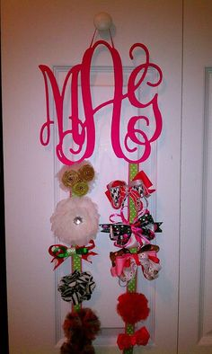 DIY: Get a wooden monogram and hot glue ribbons to the bottom & you have a baby girl/little girl hairbow holder!
