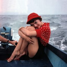 Natalie Wood in the 50s, showing us how to flirt like a pro.  And check out that red hat and sweater combo!
