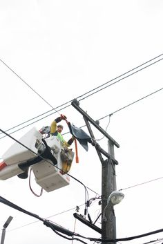 This ComEd Overhead Lineman is fixing a power line that has gotten off track. To avoid customer interruption, our linemen fix power lines while they're still energized. To keep him safe, he's wearing full safety gear and taking all precautions while working to repair this power line. Our crews do this dangerous job every day to keep the lights on! #WeAreComEd