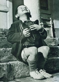 "The heartfelt-the joy of receiving a pair of shoes, 1947, following WWII ""New Shoes"" by Gerald Waller, Austria 1946 Six year-old Werfel, living in an orphanage in Austria, hugs a new pair of shoes given to him by the American Red Cross. This photo was published by Life magazine."