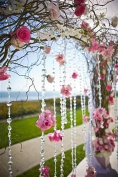 hanging floral and crystals on arch