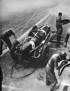 GP Italia (Monza) 1932 , Alfa Romeo P3 #8 , Driver Tazio Nuvolari , winner first place overall , Nuvolari was drinking near the camera while car have tires changed