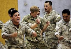 Prince Harry got involved in the haka and put all his effort into perfecting the facial expressions .