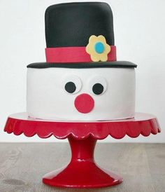 Snowman Cake Design for Kids   Make this adorable snowman cake for the kids this holiday season!