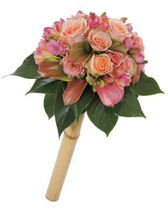bouquet of roses, Freesias, and Anthuriums with a bamboo handle