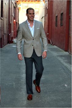 Always leave the bottom button undone when wearing a 2-button sport coat or #suit. This gentlemen has it all on right.