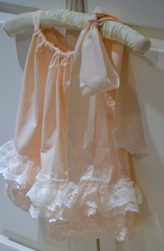 Toddler girl pink vintage pillowcase dress with ivory lace ruffles. $15.00, via Etsy.