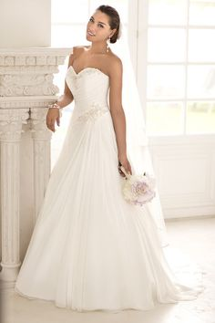 Take and elegant walk down the aisle in this dreamy Capri Chiffon A-line wedding gown featuring a figure-flattering ruched bodice with Diamante beading on its sweetheart neckline and hip. The airy skirt flows full into a court train. Style 5781 by @stellayorkbride.