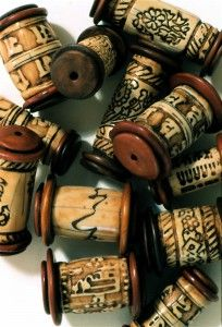DECORATED CORK BEADS? JR Hughes -- could change to be paper beads with buttons on the end