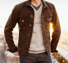 Good trucker jacket look & layering with V-neck sweater & tee shirt.