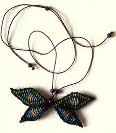 Macrame butterfly. Dark colors but with memories from last summer at https://www.etsy.com/listing/255973859/macrame-butterfly-dark