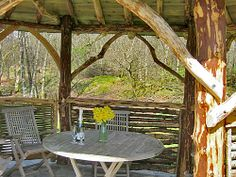 West Holmhead Cottage,  Dumfries and Galloway. Beautiful rustic summer house, with wooden table and chairs, overlooking the woodland garden http://www.organicholidays.co.uk/at/1126.htm