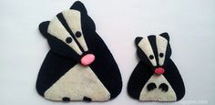 Felt Skunk Pattern.  I've made one and it looks like the one on the right.  I did it as a magnet, with the back all black.