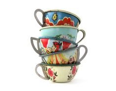 tin teacups - I'd keep my jewellery and trinkets in these... gorgeous